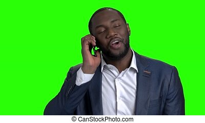 Cheerful afro american entrepreneur talking on phone. Happy...