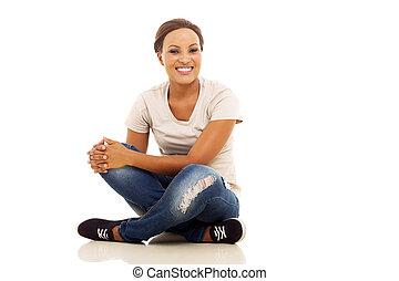 afro american girl sitting on floor