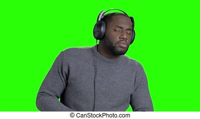 Cheerful afro-american guy in headphones.