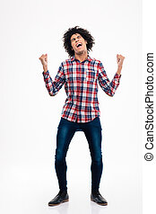 Cheerful afro american man celebrating his success