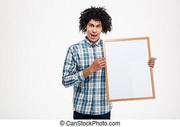Cheerful afro american man holding blank board