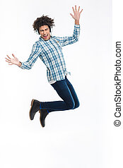 Cheerful afro american man in headphones jumping