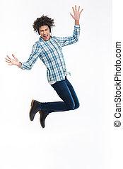 Cheerful afro american man in headphones jumping