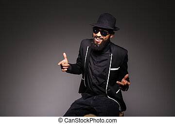 Cheerful afro american man in stylish cloth and glasses