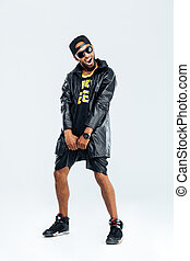 Cheerful afro american man in trendy cloth posing