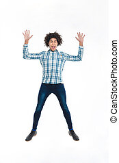 Cheerful afro american man jumping