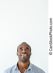Cheerful afro american man lookign up