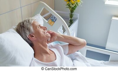 Cheerful aged in patient talking on phone - Everything is...