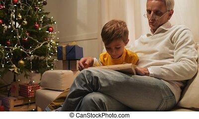 Cheerful aged man and his grandson preparing Christmas...