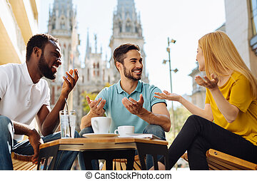 Cheerful amazing friends laughing together