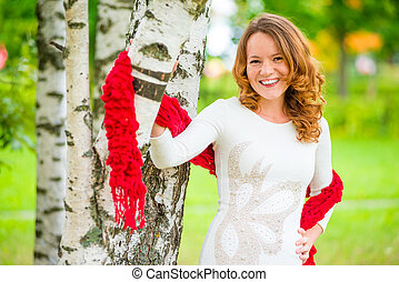 cheerful and beautiful girl in a dress in the spring park