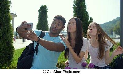 Cheerful and optimistic friends taking selfies - Super mood....