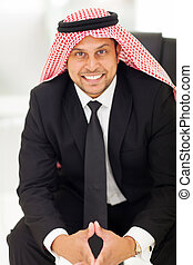 arab businessman sitting in office