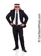 arab man in black suit - cheerful arab man in black suit...