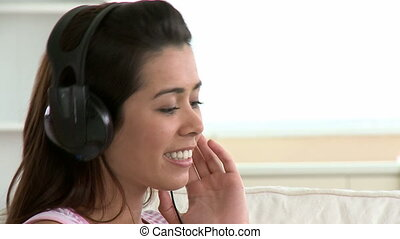 Cheerful asian woman listen music