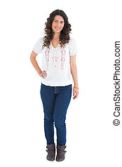 Cheerful attractive brunette wearing casual clothes posing