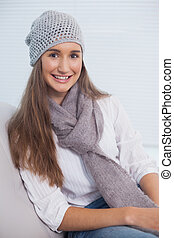 Cheerful attractive brunette with winter hat on posing