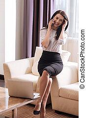 Cheerful attractive businesswoman discussing her work