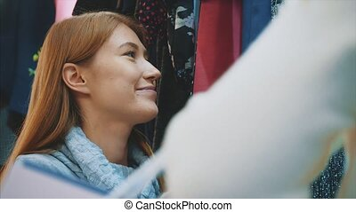 Cheerful attractive woman in the store.