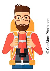 Cheerful backpacker with binoculars. - A hipster man with...