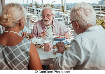 Cheerful bearded man having healthy diner in cafe - Listen ...