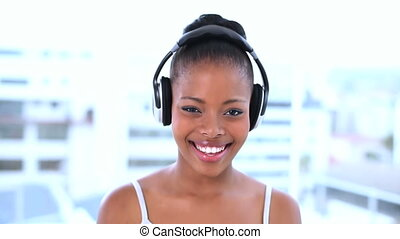 Cheerful beautiful model listening