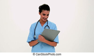 Cheerful beautiful nurse filling a