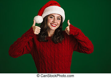 Cheerful beautiful young woman in red sweater