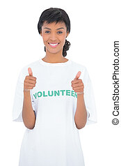 Cheerful black haired volunteer giving thumbs up
