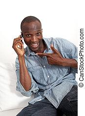 Cheerful black man talking on mobile phone