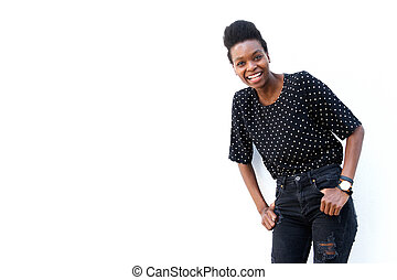 Cheerful black woman standing against white background