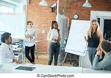 cheerful blond girl showing her ideas to the colleagues