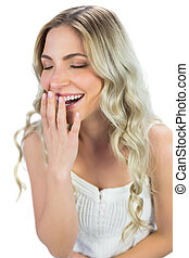 Cheerful blond model laughing