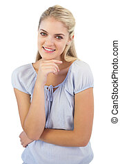 Cheerful blonde woman looking at camera