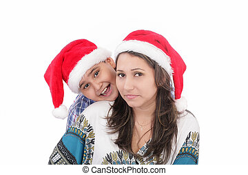 Cheerful boy and woman in Santa Claus hat. Isolated on white background