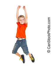 cheerful boy jumping - cheerful little boy jumping on white...