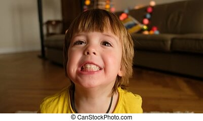 Cheerful boy looking at camera - Happy toddler smiling and ...