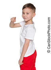 Cheerful boy pointing back