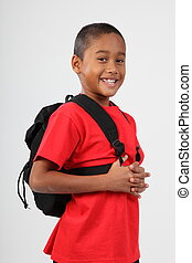 Cheerful boy ready for school with