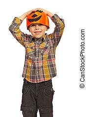 Cheerful boy with pumpkin hat