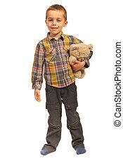 Cheerful boy with teddy bear