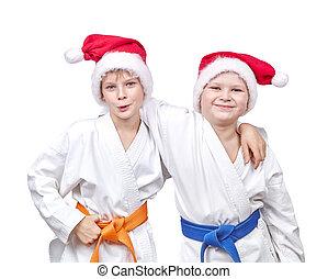Cheerful boys hugging in karategi