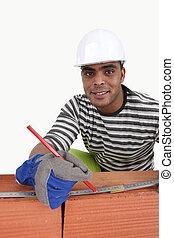 Cheerful bricklayer