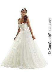 Cheerful bride posing in fashionable wedding dress