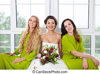 Cheerful bride with female friends
