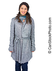 Cheerful brunette wearing winter clothes posing