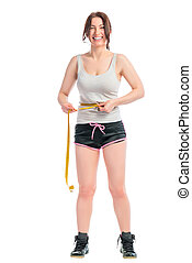 cheerful brunette with a measuring tape on a white background