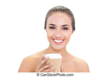 Cheerful brunette woman holding a cup of coffee