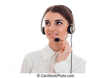 cheerful brunette woman working in call center with headphones and microphone and smiling aside isolated on white background
