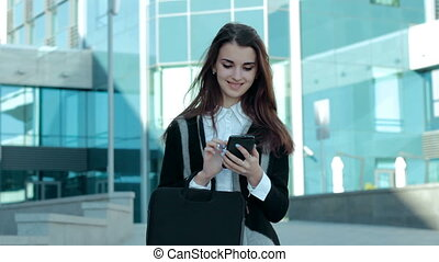 cheerful business girl working with mobile phone